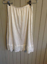Vintage small white 1/2 slip with lace hem