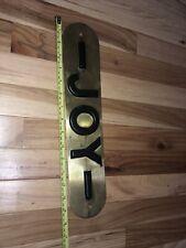 Old style Joy Mining brass tag