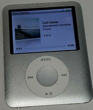 New listing Apple iPod Nano 4 Gb Mp3 Silver Music/Video Player. Pre Owned with charging cord