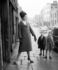 Photo. ca 1962. Ireland. Young Boys Viewing Fashion Model