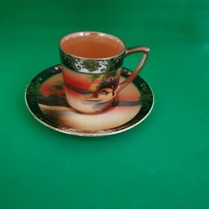 HAND PAINTED AND GILDED NORITAKE COFFEE CAN AND SAUCER