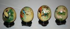 """Set of 4 small hand painted stone eggs with Stands. Approximately 2"""" X 1 1/2"""""""