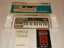 CASIO PT-50 VINTAGE 1983 KEYBOARD WITH ORIGINAL BOX ROM PACK AND BOOKS