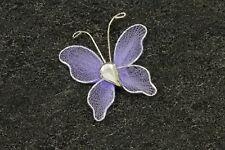 10 petits papillons parme . Décoration de mariage