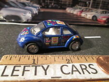 Blue VOLKSWAGEN NEW BEETLE ROLL BACK ACTION 1/64 - SCALE