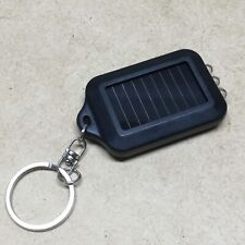 FREE SHIPPING - SOLAR POWERED MINI KEYCHAIN FLASHLIGHT W/ THREE WHITE LEDS 15