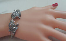 STERLING BANGLE BRACELET W, MARCASITE STUDDED LION FACES TOP W, DIAMOND EYES  SI