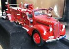 Yat Ming Road Signature 1:24 1938 Ford Fire Truck. Licensed Product. Boxed.