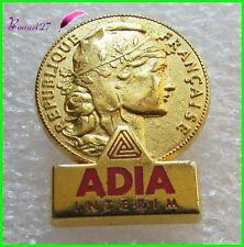 Pin's forme pièce de Monnaie République Française ADIA INTERIM Courtois  #976