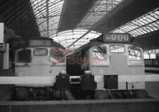 PHOTO  TYPE 2 DIESELS AT THE BUFFER STOPS OF GLASGOW (QUEEN STREET) STATION. 3/2
