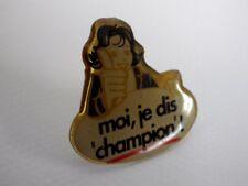 Pin's vintage publicitaire CHAMPION lot P085