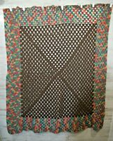 Brown, pink, green, blue and yellow crocheted blanket afghan
