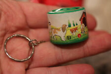 Key chain buttom once pressed, he creates the sound of the dog cute Collectible