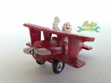 Cast Iron Small Red Aeroplane with Michelin Man Pilot Waving in Plane XMIPL
