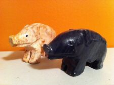 2 marble pigs bore hogs black & red figurines