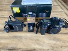 Nikon D7000 16.2 MP Digital SLR Camera body, lens, and accessories.
