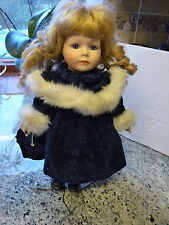 "LEONARDO COLLECTION  12""  GENUINE PORCELAIN  DOLL NEW WITH STAND"