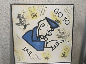 Open Road Brand Monopoly Go To Jail Embossed Tin Metal Sign 17x17 Décor