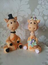 Custom edible Giraffe Bride & Groom wedding cake topper.