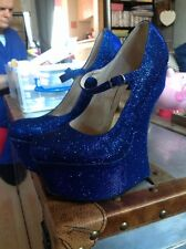 NEW bright blue sparkly anti-gravity Heel less Shoes Size 4