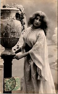 PRETTY MAID WITH AN ANCIENT URN