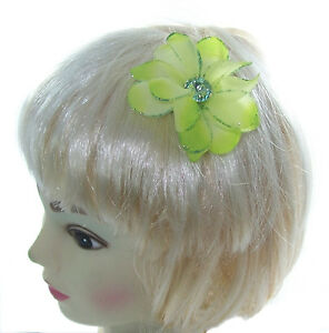 small light green hair flower with gem center on a small clip
