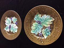 paire ancienne assiette en barbotine a décor de feuilles de vigne et raisin
