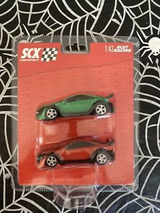 """FACTORY SEALED 2007 SCX Compact 1:43 """"Tuning"""" Slot Cars Red & Green 2 Pack"""