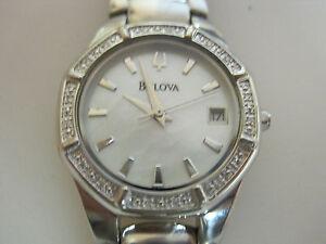 # 342 ladys stainless  steel 16 diamond bulova  date watch  bracelet