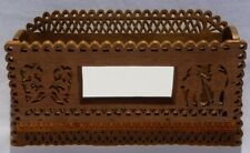 A folky hand cut fretwork folk art wall box or comb case with carved decoration.