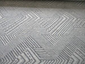 ROLL END OF 4.9 METRES OF GEOMETRIC AZTEC DESIGN UPHOLSTERY FABRIC, SILVER GREY
