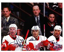 Steve Yzerman/Red Wings reprinted auto. 8 x 10 photo with 4 other Red Wings