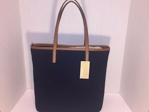 michael kors tote bag; navy blue fabric, with tan handles and trim, gold zipper