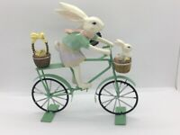 FAO SCHWARZ SPRING EASTER FIGURINE BUNNY ON BICYCLE WITH KID AND BASKET
