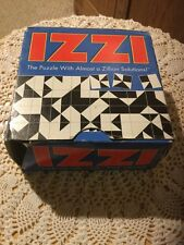Pre Owned IZZI.  The Puzzle With Almost A Zillion Solutions!  Box Shows Wear.