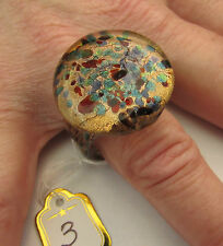 A ROUND LAMPWORK GLASS RING. UK..T. US..9.5.   (25mm x 25mm)  (3)