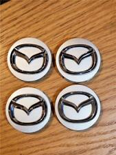 Mazda Center Caps Set of 4 OEM