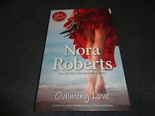CLAIMING LOVE  BY  NORA ROBERTS (LARGE PAPERBACK BOOK)