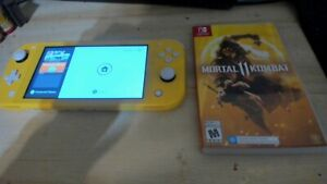 nintendo switch lite yellow, barely used, missing charger with Mortal Kombat 11