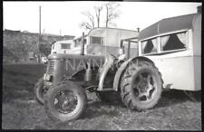 A Small format negative - TODDLER onTRACTOR ready to tow CARAVAN!