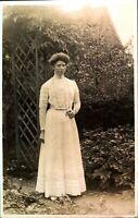 Portrait Victorian lady in garden RPPC postcard real photograph antique