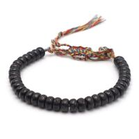 BENAVA Tibet Armband mit Mantra Zeichen Kokosnuss Perlen Schwarz Bunt Geflochten