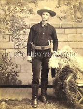 ANTIQUE REPRO 8X10 PHOTO OF COWBOY WITH PISTOL CARTRIDGE BELT AND KNIFE