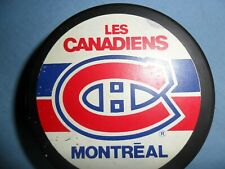 ONE MONTREAL CANADIAN GAME USED HOCKEY PUCK