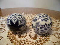 TWO BLUE AND WHITE PORCELAIN CARPET BALLS ONE WITH BLUE STAR