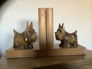 VINTAGE CARVED WOODEN SCOTTIE DOGS BOOKENDS WITH GLASS EYES