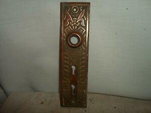 stamped Eastlake/ Victorian brass door knob backplate