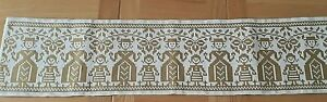 Green woven table runner with Swedish folk design