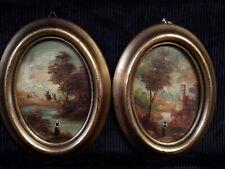 Coppia di antiche miniature ovali con cornice in legno