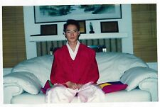 Found PHOTO Young Asian Man in Traditional Garb Sitting on Couch